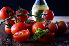 Enjoyment of Italian food. Wet tomatoes on an old table Stock Photography