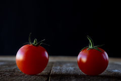 Enjoyment of Italian food. Wet tomatoes on an old table Royalty Free Stock Images