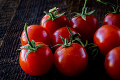 Enjoyment of Italian food. Wet tomatoes on an old table Royalty Free Stock Photography