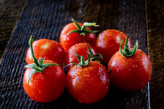 Enjoyment of Italian food. Wet tomatoes on an old table Royalty Free Stock Photo