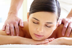 Enjoyment. Portrait of calm female enjoying luxurious procedure of massage royalty free stock photo