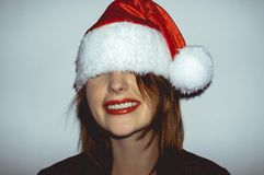 Enjoyment Santa girl Stock Image