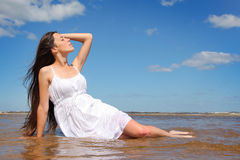 Enjoyment on sea. Beautiful young woman relaxing on sea Royalty Free Stock Photography