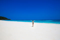 Enjoyment. Seashore. Happy free woman Raising Hands or Open arms Stock Image