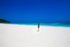 Enjoyment. Seashore. Happy free woman on tropical beach, exotic Royalty Free Stock Photo