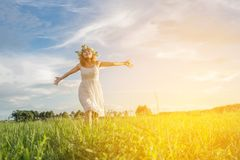 Enjoyment.Young Happy Woman Enjoying Nature at meadows. stock image
