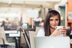 Enjoyng a coffee at cafe Royalty Free Stock Images