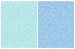2 enkel abstrakt polka Dots Vector Patterns Den vita ojämna borsten pricker på ett ljust - blå bakgrund stock illustrationer