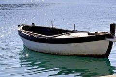 Enkel fiskebåt med starburst Royaltyfria Foton