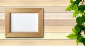 Enkel fotoram på wood bakgrund Arkivbilder