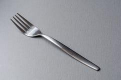 Enkel gaffel på grå bakgrund Royaltyfria Foton