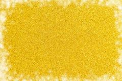 Enkel guld- Glittle bakgrund med en gräns för vitt ljus royaltyfri foto