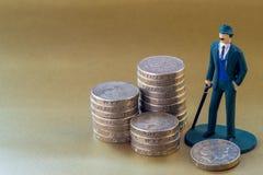 Enkel leksak och engelska för affärsman miniatyrett pund mynt Arkivfoto