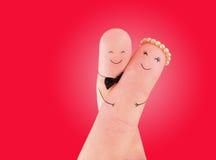 Enkel schilderde het echtpaar - jonggehuwden bij vingers Royalty-vrije Stock Foto's