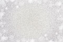 Enkel silverGlittle bakgrund med en gräns för vitt ljus royaltyfri bild