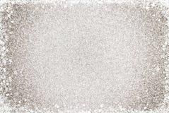 Enkel silverGlittle bakgrund med en gräns för vitt ljus arkivbilder