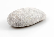 Enkel sten som isoleras på vit bakgrund Royaltyfri Fotografi