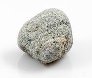 Enkel sten som isoleras på vit bakgrund Arkivfoton