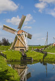 Windmill in a sunny Dutch landscape Stock Photo