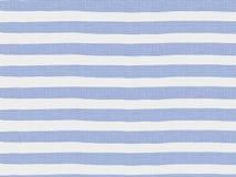Enkla blått gjord randig modell på linnetyg Arkivfoto
