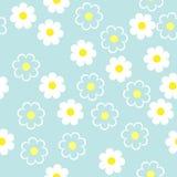 Enkla schematiska vita blommor på en blå bakgrund Blom- söm Royaltyfri Fotografi