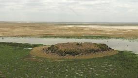 Enkongu swamp and volcanic rock formation at amboseli