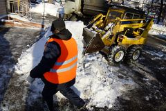 Enlève la neige Photos libres de droits