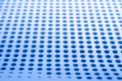 Abstract light colored surface with holes built in a row for creativity, wallpapers and backgrounds. Stock Images