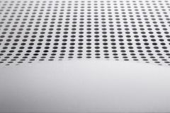 Abstract light colored surface with holes built in a row for creativity, wallpapers and backgrounds. Stock Image