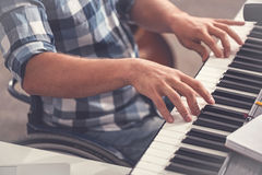 Enlarged photo of male fingers lying on piano Stock Photos