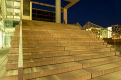 Enlighted stairs close to a river. Lighted stair close to a river in a blue night Royalty Free Stock Photo