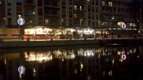 enlightened Xmas market stalls at Darsena, Milan, Italy stock video footage