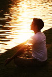 Enlightenment. Young Indian man in deep meditation radiating light and peace Stock Photo