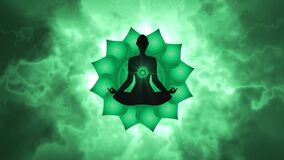 Silhouette of the person meditating activate the heart chakra