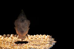 Enlightenment. Spiritual image of serene buddha head illuminated royalty free stock image
