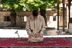 Enlightenment. Young Muslim Man Making Traditional Prayer To God While Wearing A Traditional Cap Dishdasha Stock Photos