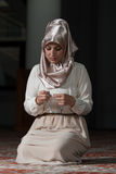 Enlightenment. Young Muslim Woman Praying In Mosque Royalty Free Stock Photo