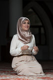 Enlightenment. Young Muslim Woman Praying In Mosque Stock Images