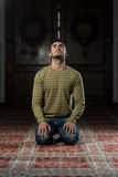 Enlightment. Muslim Man Is Praying In The Mosque Stock Image