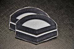 Insignia. Full corporal insignia for my promotion before leaving 2 year service in the Republic of Singapore Air force (RSAF Stock Photos