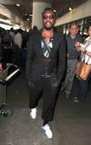 Ennegrezca al cantante eyed Will.i.am del líder de los guisantes en LAX imagen de archivo libre de regalías