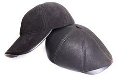 Ennegrezca el casquillo de los deportes de la pana y el casquillo de cuero negro Fotos de archivo libres de regalías