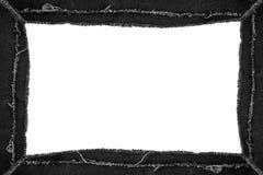 Ennegrezca el marco rasgado de los vaqueros con el espacio de la copia fotografía de archivo