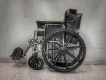 Ennegrezca el sillón de ruedas Imágenes de archivo libres de regalías