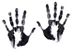 Ennegrezca la imagen de la tinta de un par de handprints Imágenes de archivo libres de regalías