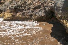 Ennegrezca la playa volcánica de la arena Isla de Tenerife Imagen de archivo libre de regalías