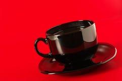 Ennegrezca la taza de café Fotografía de archivo libre de regalías