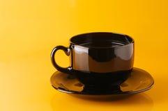Ennegrezca la taza de café Fotografía de archivo