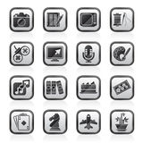 Ennegrezca las aficiones y los iconos blancos del ocio Foto de archivo libre de regalías