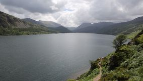 Ennerdale Water Lake District National Park Cumbria England uk. Surrounded fells including Great Gable, Green Gable, Brandreth, High Crag, Steeple and Pillar stock footage